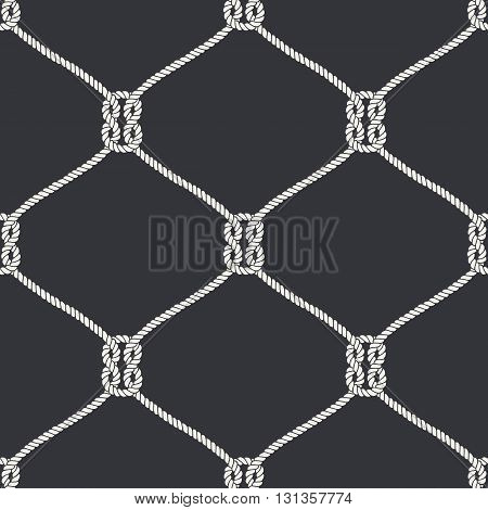 Seamless nautical rope knot pattern. Endless navy illustration with white fishing net ornament and marine knots on black backdrop. Trendy maritime style background. For fabric, wallpaper, wrapping.