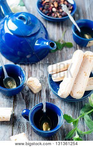Tea set, herbal tea and cookies Savoiardi