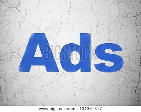 Marketing concept: Blue Ads on textured concrete wall background