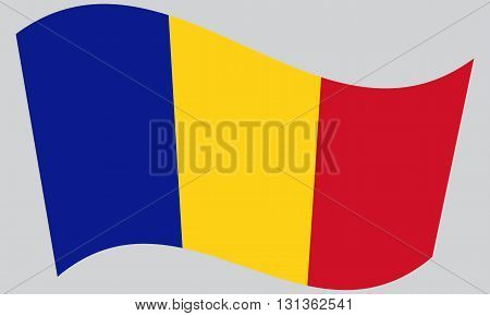 Flag of Chad waving on gray background