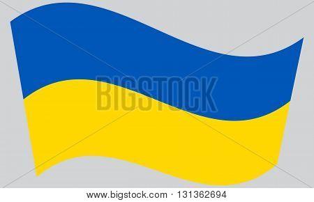 Flag of Ukraine waving on gray background