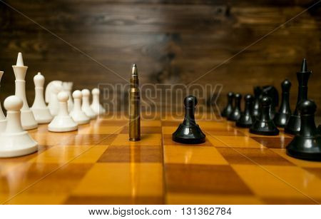 Conceptual photo of using bullet instead of chess piece. Concept of military power