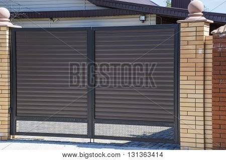 Gates Of Brown Metal Sheets. Roofing Materials.