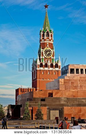 Spasskaya tower in Moscow Russia. Lenin mausoleum on Red square