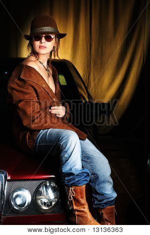 Portrait of a styled professional model in a car session.