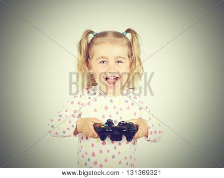 Little Girl Playing Video Games With Gamepad In Hands.