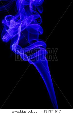 Abstract art. Color aquamarine smoke from the aromatic sticks on a black background. Background for Halloween. Texture fog. Design element. The concept of aromatherapy.