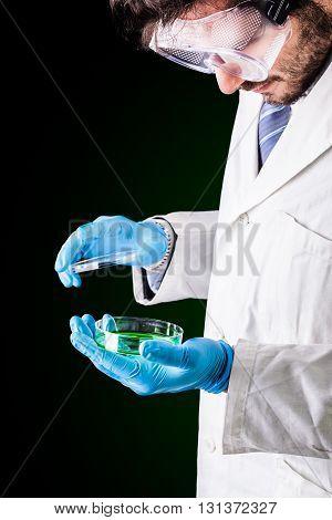 Researcher Opening A Petri Dish