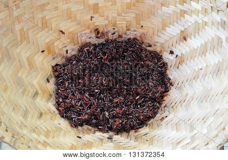 black sticky rice in bamboo earthenware steamer