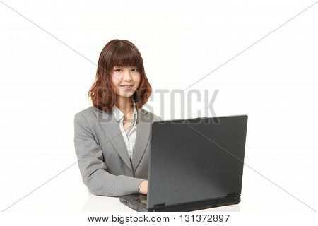 studio shot of young Japanese businesswoman smiles on white background