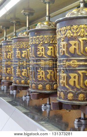 prayer wheels in thekchen choling temple singapore