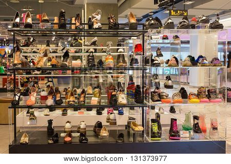 BANGKOK THAILAND - NOVEMBER 19 2013 : Lot women shoes on a glass shelf at the Siam Paragon Mall. Siam Paragon is a one of the biggest shopping centres in Asia.
