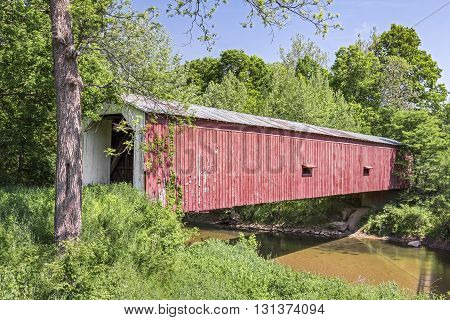 Built in 1854 Cades Mill Covered Bridge crosses Coal Creek in rural Fountain County Indiana.