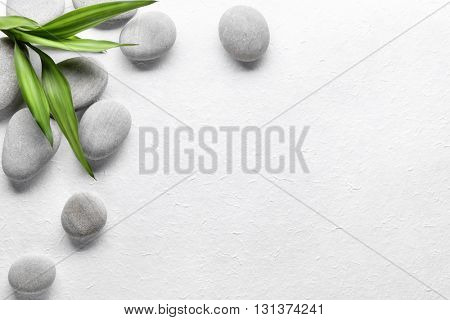 Spa stones with bamboo on paper