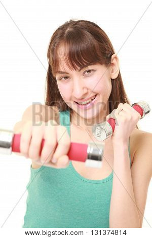 studio shot of woman doing dumbbll exercise