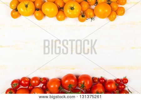 Different kinds of fresh tomatoes on grunge wooden surface top view