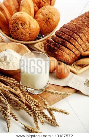 Baking Ingredients, Milk, And Pastry On White Background