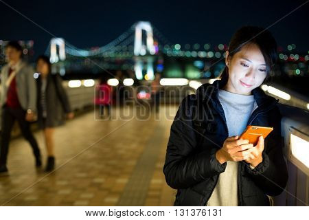Woman sending text message on phone