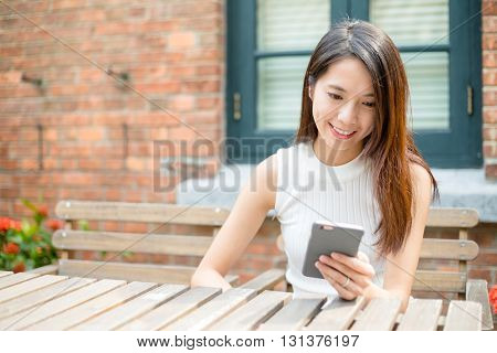 Young Woman sending message on cellphone