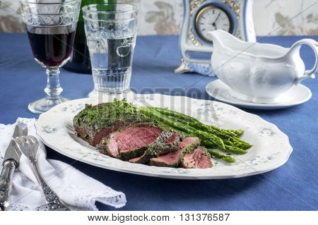 Roast Beef with Green Asparagus on Plate