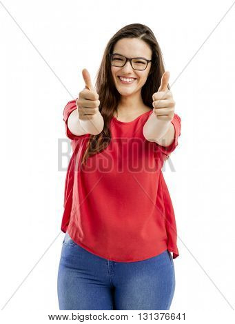 Beautiful and confident woman with thumbs up, isolated over white background