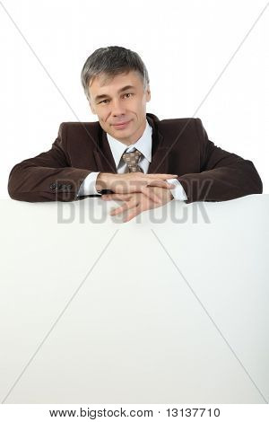 Business background: handsome businessman with white display