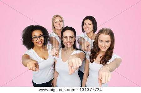 choice, friendship, body positive, gesture and people concept - group of happy different size women in white t-shirts pointing finger on you over pink background