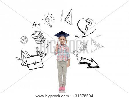 childhood, school, education, learning and people concept - happy girl with in bachelor hat or mortarboard with doodles