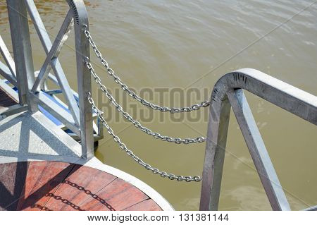 close up iron fence near river in thailand