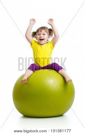 child girl doing gymnastics with fitness ball over white background