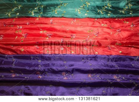 Different color and texture of silk scarf closeup