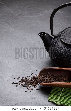 Asian teapot over stone table. View with copy space