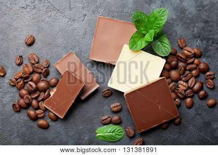 Chocolate and coffee beans on dark stone table. Top view