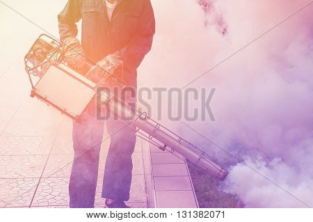 Vintage background fogging to eliminate mosquito for prevent spread dengue fever