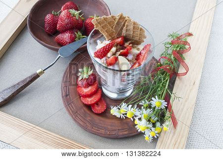 dessert with strawberries and bananas,still life of dessert with fruits and flowers.