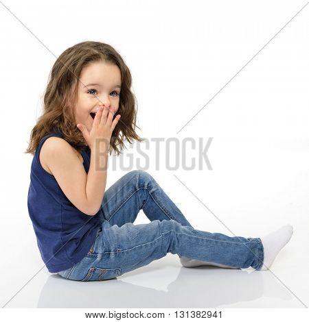Sweet little emotional girl, studio portrait over white background