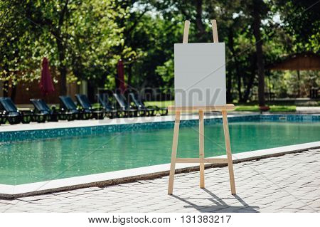 White Empty Easel At The Pool