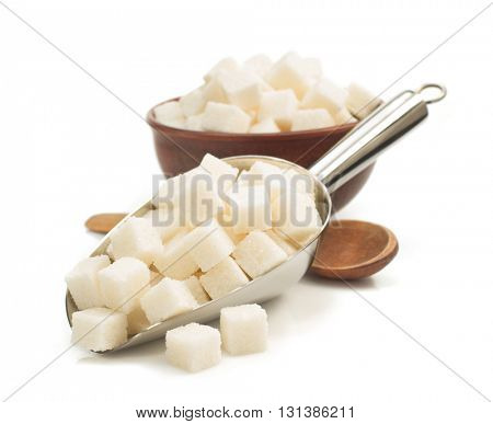 sugar cubes in scoop isolated on white background