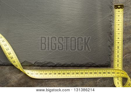 measuring tape on table background