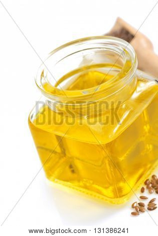 linseed oil in bottle isolated on white background