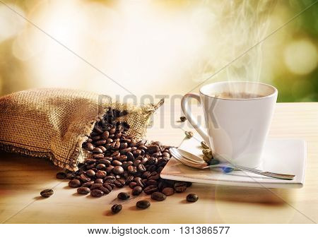 Cup Of Coffee With Green Nature Background Elevated View