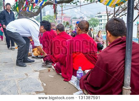 KathmanduNepal - May 21 2016 : Monks are begging in Swayambhunath Stupa on Buddha's Birthday or Buddha Jayanti.