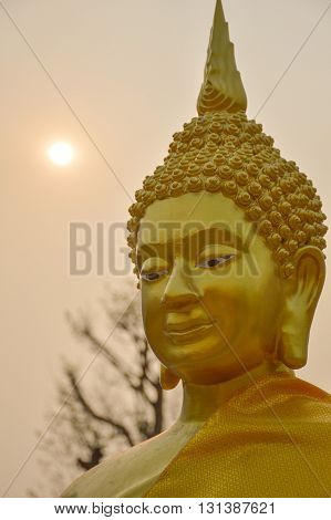 close up gold buddha statue in public temple Thailand