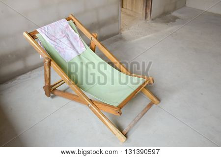 close up green fabric chair on cement floor