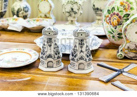 Delft, Netherlands - April 8, 2016: Pottery workpieces with hand painting of Delftware in the Delft pottery factory, Royal Delft