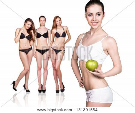 Beautiful woman holds green apple. Concept of dieting healthy lifestyle