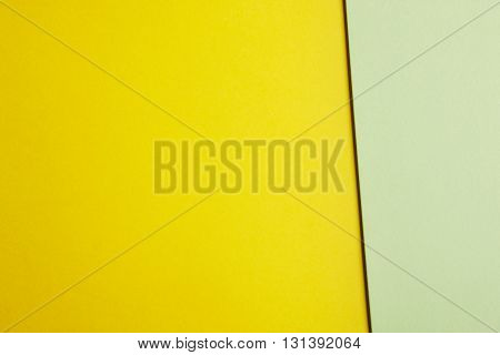 Colored cardboards background in yellow green tone. Copy space. Horizontal