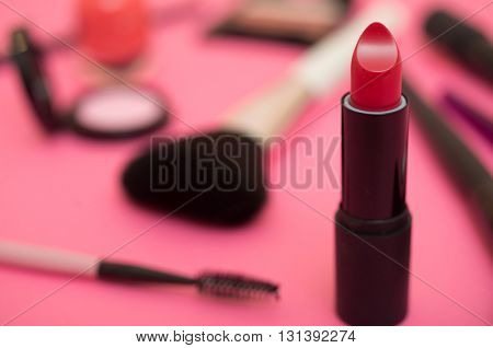 Make-up products and tools. Pink background