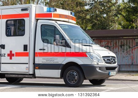 ALTENTREPTOW / GERMANY - 1. MAY 2016: german emergency ambulance vehicle stands on the street in altentreptow on may 2016.