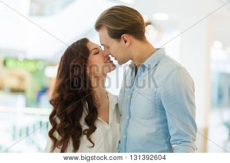Young couple kissing in a mall